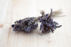 Two bunches of dried lavender on a wooden table Stock Photo