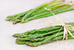 Two bunches of fresh asparagus Royalty Free Stock Photography