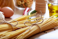 Two bunches of raw spagetti pasta. Two bunches of spagetti pasta Royalty Free Stock Image