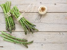 Two bundles of fresh green organic asparagus royalty free stock photography