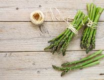 Two bundles of fresh green organic asparagus stock photo