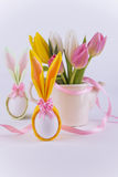 Two bunny napkin eggs for easter and flowers on white background Stock Image
