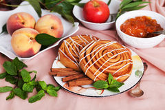 Two buns with cinnamon still life Royalty Free Stock Photo