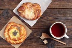 Two buns and tea Stock Photo