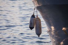 Two buoy used by the boats to do not crash at the harbour stock photos