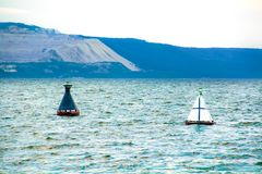 Two buoys in the river stock photos