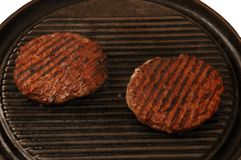 Two burgers. Cooking close up Royalty Free Stock Photos