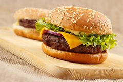 Two burgers. Homemade grilled hamburgers on wooden board Stock Images
