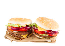 Two Burgers on paper Royalty Free Stock Photography