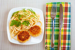 Two burgers, pasta and parsley Stock Photography
