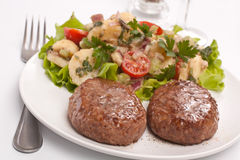 Two Burgers with Potato Salad Stock Photography