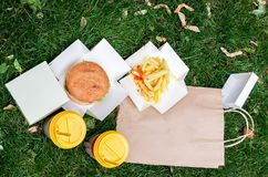 Two burgers and two coffees. Food for two. Top view Royalty Free Stock Photo