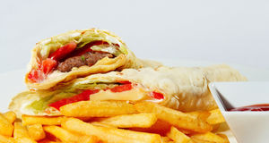 Two buritto. With fries and red sauce Royalty Free Stock Images