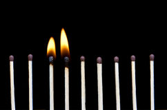 Two burn and  unburned matches Stock Photo