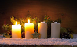Two burning advent candles and Christmas decoration. Royalty Free Stock Photos