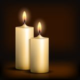 Two burning candles on black background. Royalty Free Stock Photos