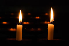 Two burning candles on a dark background Royalty Free Stock Photography