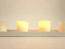 Two Burning candles. Two of Four Candles are burning in Candlestick in white Background Stock Photography