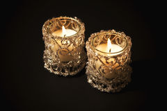 Two burning candles in glass candlesticks Royalty Free Stock Photos