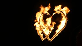 Two burning hearts on wedding fireshow. Slow motion stock video footage