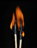 Two burning match Stock Photography