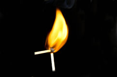 Two burning matchsticks Royalty Free Stock Image