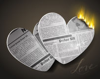Two burning newspaper heart Stock Images