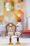 Two burning oil lamps on altar Royalty Free Stock Photos