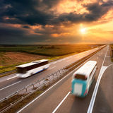 Two buses on highway in motion blur Stock Image