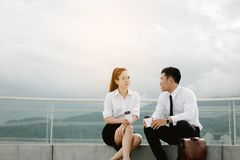 Two businees people couple talking about work in morning. royalty free stock photo