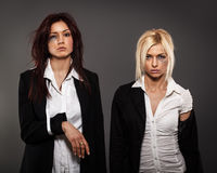 Two busines woman after fight Royalty Free Stock Image