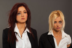 Two busines woman after fight Stock Image