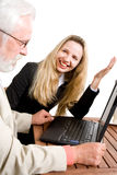 Two business associates. A blond business woman gesturing to her colleague Royalty Free Stock Photography