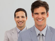 Two Business associates standing in a line Stock Photos