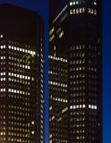 Two business buildings in Frankfurt at night. Stock Image
