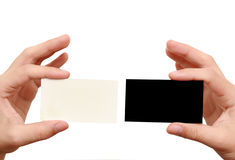 Two business cards in hands. On white background Royalty Free Stock Photography