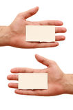 Two business cards in hands Royalty Free Stock Images