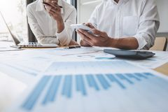 Two business colleague meeting to brainstorm the new project business strategy plan and analysis data document, finance and. Accounting concept Briefing stock photo