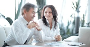 Two business colleagues discussing a financial report stock photos