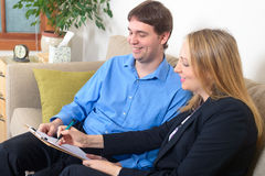 Two business colleagues discussing project document in the office stock image