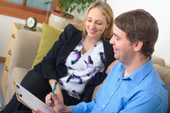 Two business colleagues discussing project document in the office stock images
