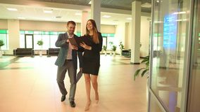 Two business colleagues in discussion. In office , businessman and businesswoman stock video footage