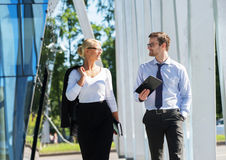 Two business colleagues in formalwear being outside Royalty Free Stock Image