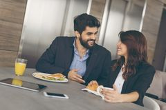 Free Two Business Colleagues Having Breakfast Stock Image - 116873821