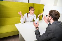 Two business colleagues having debate and sitting stock photo