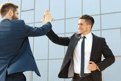 Two  business colleagues high-fiving Royalty Free Stock Photography