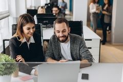 Two business colleagues at meeting in modern office interior royalty free stock photos
