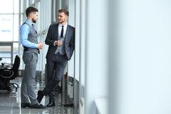 Two business colleagues at meeting in modern office interior. Royalty Free Stock Photography