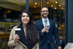 Two business colleagues purchasing takeaway coffee Stock Photo