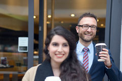 Two business colleagues purchasing takeaway coffee Royalty Free Stock Photos